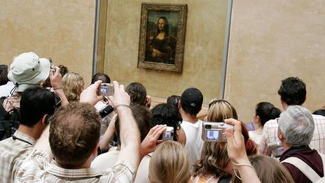 Tourists Taking Pictures of the Mona Lisa at the Louvre Museum Paris France