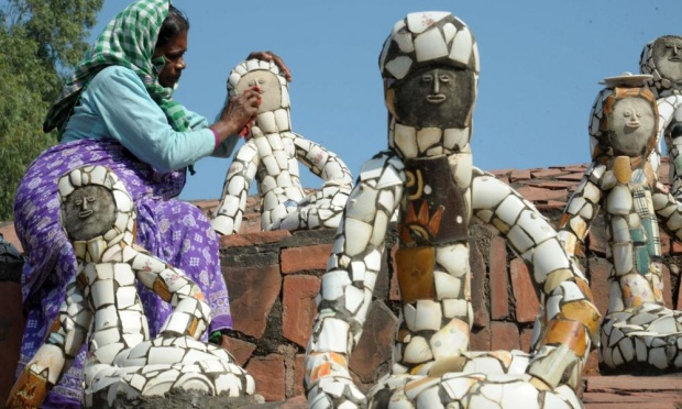 A worker cleans sculptures in Nek Chand's Rock Garden of Chandigarh. Photograph: Narinder Nanu/AFP/Getty Images